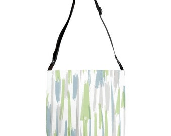 A touch of brush adjustable strap tote