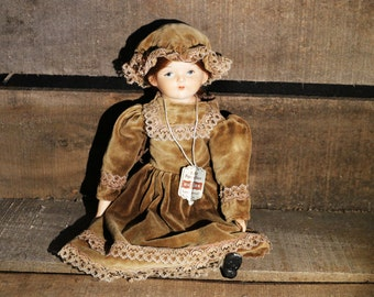"""Vintage Wupper German Hand painted Porcelain 11"""" collectors doll with original label"""