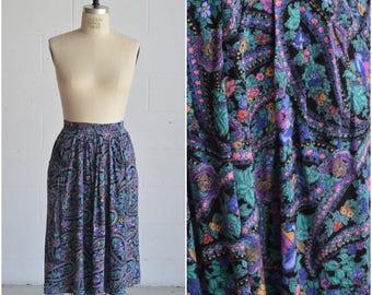 1980s purple floral skirt · knee length ditsy print skirt · side pocket abstract print skirt · casual fun bright high waisted skirt · medium