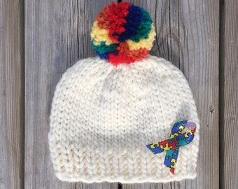 "Touque/hat, rainbow pompom, charity donation, autism awareness, ""True Colours"""