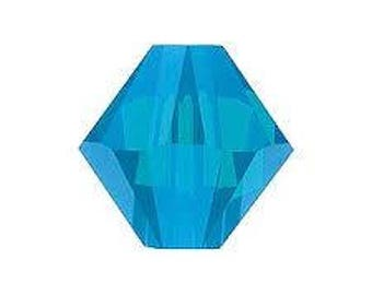 Swaovski Bicone bead 5301 Caribbean blue opal 6mm - Quantity of 9 beads