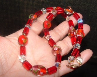 vintage stunner necklace 80s all very nice GLASS BEADS LAMPWORK and tube beads in orange/red nice clasp