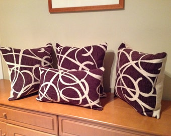 Burgundy and cream cushion