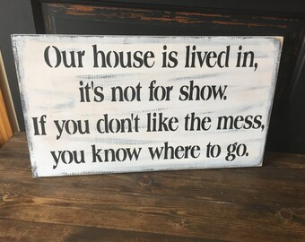 Our house is lived in, not for show, sign
