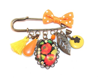 Broche florale orange et jaune