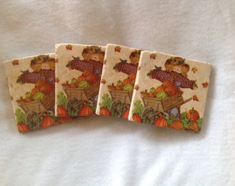 """Scarecrow autumn coasters for the upcoming holidays,  made out of 4"""" x 4"""" natural stone tiles"""