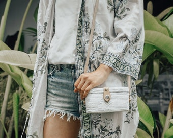 The white natural Ata grass bag , a must have for every boho girl this summer