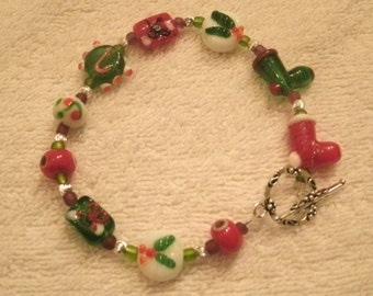Holiday Lampwork Glass Bead Santa Boot and Holly Leaf Red and Green Bracelet