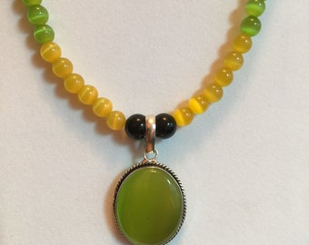 """Semi Precious Cat's Eye both Yellow and Green Necklace 20"""" Long , with a Sterling Silver Green Cat's Eye Pendant with Onyx on its Sides"""
