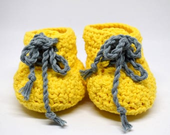 "Shoes ""sneakers"" crochet yellow with blue laces all gentle on baby birth gift. Hand made in Switzerland & unique."