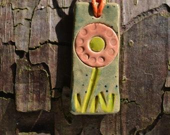 Ceramic glazed pendant: handmade, flower design, green and soft orange