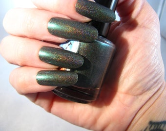 The First Kiss is Poison holographic nail polish from The Good Fight collection by Comet Vomit