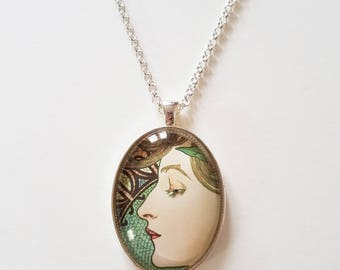 Alfons Mucha 'Visage' detail, 30x40mm oval, glass cabochon pendant, including complimentary chain