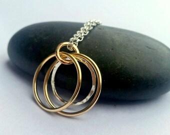 Silver gold hoop pendant.