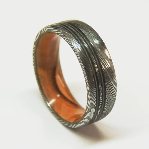 stainless damascus steel ring bethlehem olive wood liner