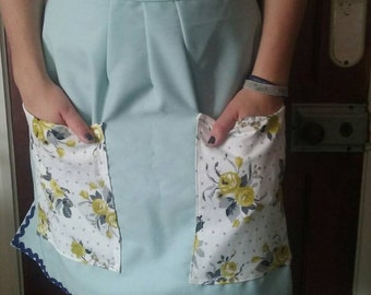 Ladies half apron in pale blue with two large front pockets and Rick rack trim