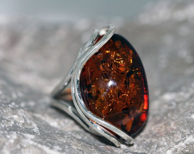 Dark cognac Baltic Amber Ring fitted in sterling silver setting. Handmade & unique.
