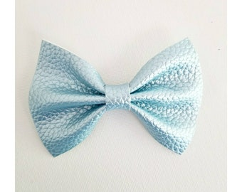 Blue metallic bow on clip or headband