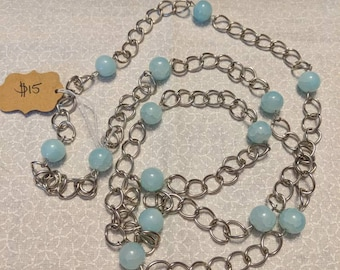 Long blue bead and chain necklace