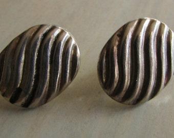 Sterling Silver Post Earrings.