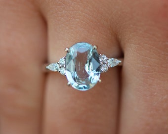 Eidelprecious Mint Campari ring. Mint sapphire engagement ring. Light blue green sapphire 2.24ct oval diamond Campari ring 14k White gold.
