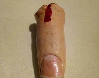 Severed finger pendant