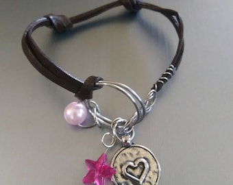 Love leather bracelet with charms.