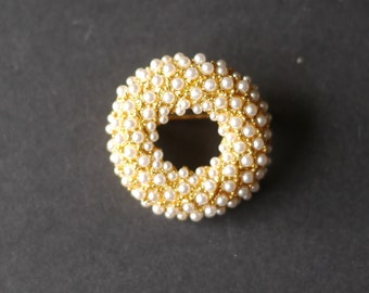 Gold tone circular brooch with lots of tiny pearl beads
