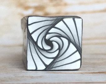Polymer clay cane, paradox, black, white