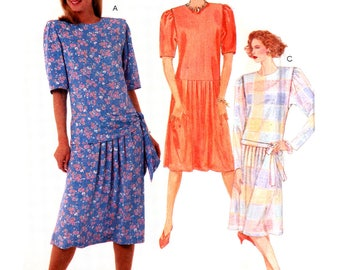 80s McCall's 2604 Dropped Waist Dress with Pleated Skirt, Long or Short Sleeves and Tie Belt, Uncut, Factory Folded Sewing Pattern Size 12