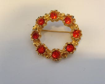 Gold Coloured Wreath Brooch with Orange Stones