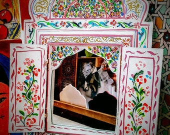 Wooden mirror painted with Moroccan motifs