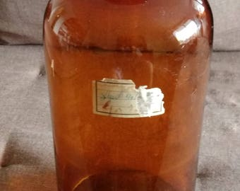 Antique apothecary bottle in amber glass