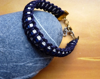 Purple braided bracelet and leather