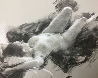 Reclining figure in charcoal and chalk on pastel paper