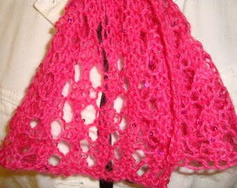 Lacy handknit fuschia scarf with scattered tiny sequins. An all occasion accessory.