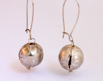 silver modern long earrings. Contemporary, original and elegant jewelry.