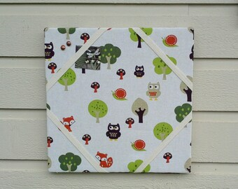Linen blend Pinboard,Woodland Creatures featuring owls, foxes, snails and trees in bright greens and oranges on off white, childrens decor