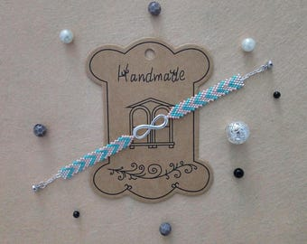 Pink, turquoise and silver infinity charm bracelet