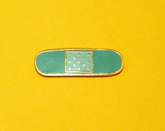 Bandage - Hard enamel lapel pin
