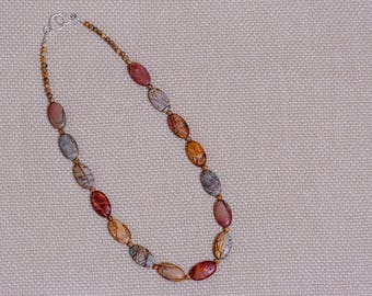 "Beaded necklace of Red Creek Jasper, 23.5"" long. All sterling silver components including hook and eye clasp."