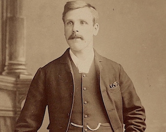 Cabinet card, antique.   Featuring a well dressed young gentleman. A. & G. Taylor, 95 Newgate St. Newcastle. c late 1890's.