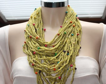 Crocheted necklace with Chenille yarn mixed with microsequins or gold lurex yarn and wood or colored corals