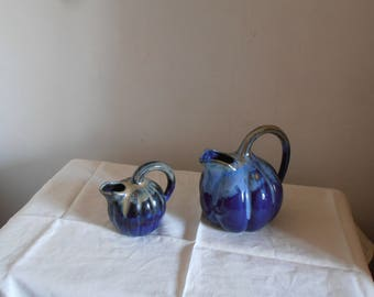Two French vintage blue pitchers