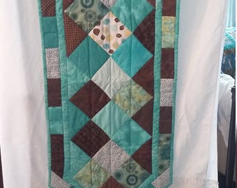 Turquoise and brown print charm square table runner