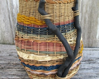 Contemporary Basket with Driftwood and Other Natural Embellishments by Marcia Whitt