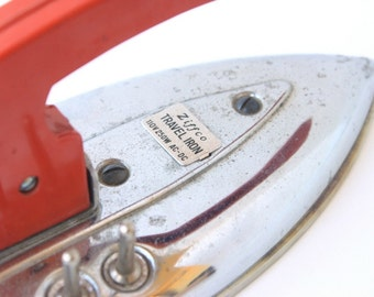 Vintage metal Ziffco foldable travel iron with red handle