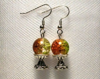 Green and brown glass crystal ball on a silver plated stand earrings