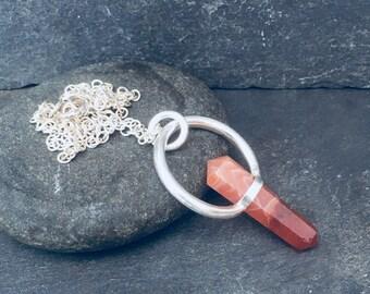 Handmade Carnelian and Sterling Silver pendant.