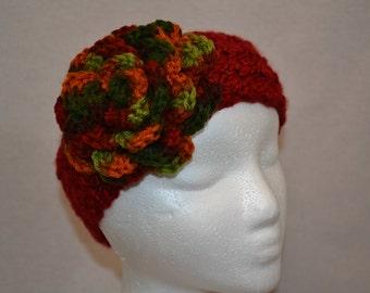 Crochet earwarmer with crochet flower